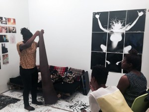 Hernease Davis shows her knitting work and B&W lifesize photogram (on the wall) at a recent critique.